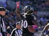 Running back Bernard Pierce #30 of the Baltimore Ravens celebrates after scoring a touchdown in the second quarter of a game against the Atlanta Falcons at M&T Bank Stadium on October 19, 2014