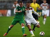 Germany's forward Lukas Podolski and Ireland 's Glenn Whelan vie for the ball during the UEFA Euro 2016 Group D qualifying football match Germany vs Republic of Ireland in Gelsenkirchen, western Germany on October 14, 2014