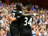 Mohamed Diame of Hull City celebrates with team-mate Hatem Ben Arfa after scoring their first goal during the Barclays Premier League match between Arsenal and Hull City at Emi