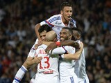 Lyon's French midfielder Yoann Gourcuff celebrates with his teammates after scoring a second goal during the French L1 football match Lyon (OL) vs Montpellier (MHSC) on October 19, 2014