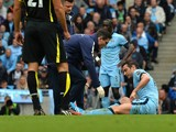 Manchester City's English midfielder Frank Lampard lies injured during the English Premier League football match between Manchester City and Tottenham Hotspur at the The Etihad Stadium in Manchester, north west England on October 18, 2014