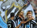 Newcastle player Gabriel Obertan celebrates his goal with team mates during the Barclays Premier League match between Newcastle United and Leicester City at St James' Park on October 18, 2014