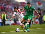 Ryan Casciaro of Gibraltar and Stephen Ward of Republic of Ireland battle for the ball during the EURO 2016 Qualifier match between Republic of Ireland and Gibraltar at Aviva Stadium on October 11, 2014