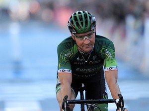 France's cyclist Thomas Voeckler of team Europcar crosses the finish line of the 108th edition of the Paris-Tours one-day cycling race over 237.5km, on October 12, 2014