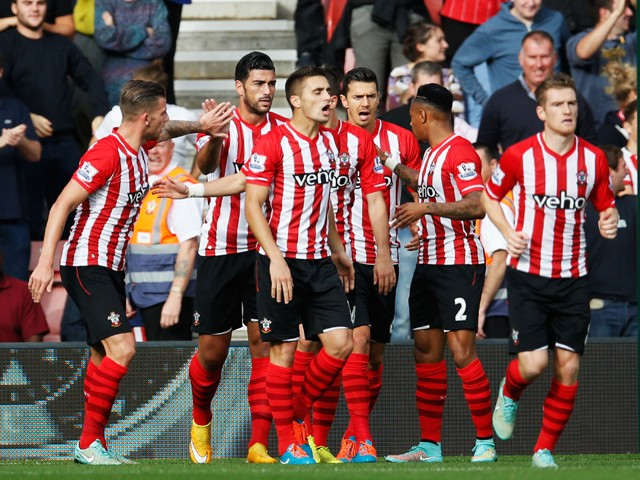 Graziano Pelle of Southampton celebrates with team mates as he scores their second goal during the Barclays Premier League match between Southampton and Sunderland at St Mary's Stadium on October 18, 2014