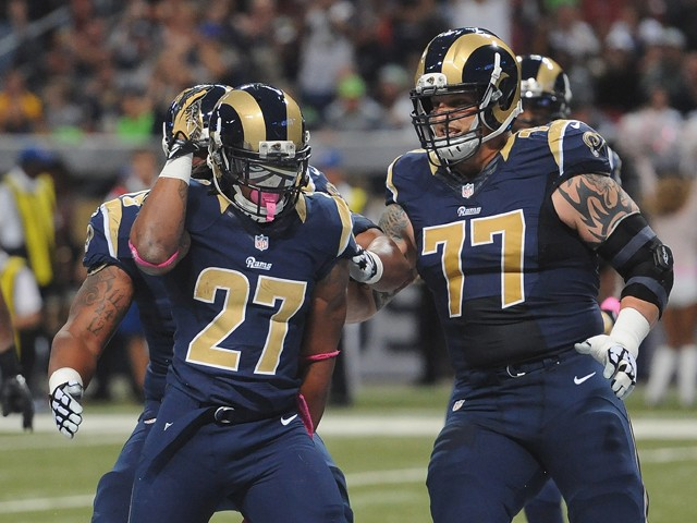 Tre Mason #27 of the St. Louis Rams celebrates a first-quarter touchdown against the Seattle Seahawks at the Edward Jones Dome on October 19, 2014
