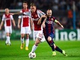 Andres Iniesta of FC Barcelona duels for the ball with Niki Zimiling of AFC Ajax during a UEFA Champions League Group F match on October 21, 2014