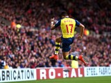 Alexis Sanchez of Arsenal celebrates after scoring the opening goal during the Barclays Premier League match between Sunderland and Arsenal at the Stadium of Light on October 25, 2014