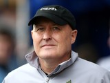 Cardiff manager Russell Slade looks on ahead of the Sky Bet Championship match between Millwall and Cardiff City at The Den on October 25, 2014
