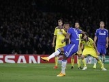 Chelsea's Ivorian striker Didier Drogba scores their second goal from the penalty spot during the UEFA Champions League, Group G, football match on October 21, 2014