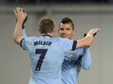 Manchester City's English midfielder James Milner celebrates with Argentinian striker Sergio Aguero after scoring his team's second goal during the UEFA Champions League match at CSKA Moscow on October 21, 2014