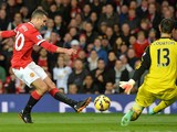Manchester United's Dutch striker Robin van Persie shoots but Chelsea's Belgian goalkeeper Thibaut Courtois saves during the English Premier League football match between Manchester United and Chelsea at Old Trafford in Manchester, north west England, on