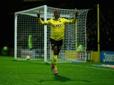 Odion Ighalo of Watford celebrates scoring the first goal during the Sky Bet Championship match between Watford and Nottingham Forest at Vicarage Road on October 21, 2014