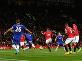 Manchester United striker Robin van Persie fires home the equaliser against Chelsea at Old Trafford on October 26, 2014