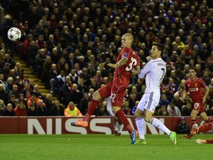 Real Madrid's Portuguese forward Cristiano Ronaldo scores the opening goal during the UEFA Champions League, group B, football match between Liverpool and Real Madrid at Anfield in Liverpool, northwest England, on October 22, 2014