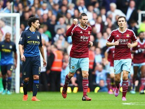 Morgan Amalfitano of West Ham United celebrates scoring the opening goal during the Barclays Premier League match between West Ham United and Manchester City at Boleyn Ground on October 25, 2014