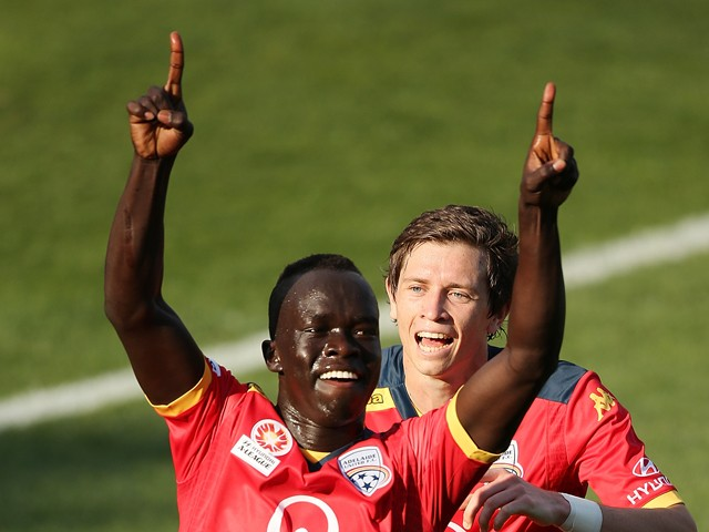 Awer Mabil (#17) of Adelaide Unitedcelebrates after scoring a goal during the round three A-League match between Adelaide United and the Perth Glory at Coopers Stadium on October 26, 2014