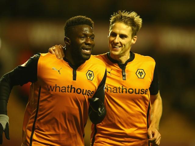 Bakary Sako of Wolverhampton Wanderers celebrates his penalty goal with team mate Dave Edwards during the Sky Bet Championship match on October 21, 2014