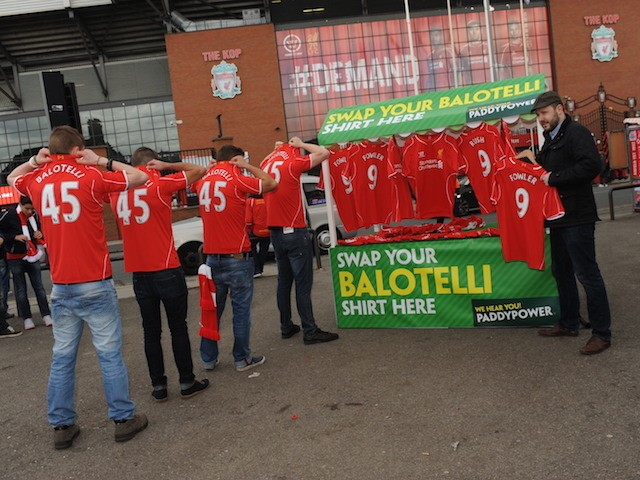 Liverpool fans outside Anfield are offered a replacement shirt for their 'Balotelli 45' replicas by Paddy Power