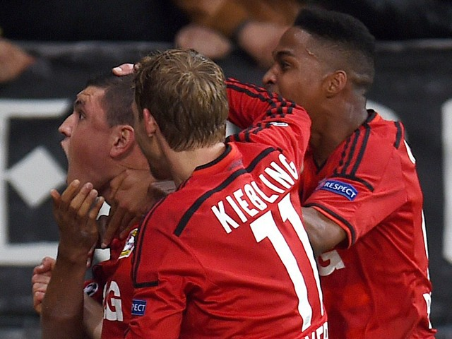 Greek defender Kyriakos Papadopolous celebrates scoring with his team-mates Stefan Kiessling and Brazilian defender Wendell during the first leg UEFA Champions League Group C football match Bayer 04 Leverkusen vs FC Zenit St Petersburg, in Leverkusen, wes