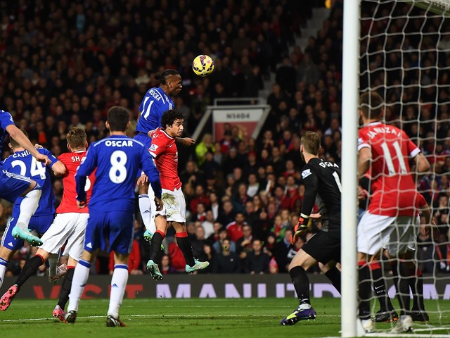 Didier Drogba of Chelsea scores the first goal during the Barclays Premier League match between Manchester United and Chelsea at Old Trafford on October 26, 2014