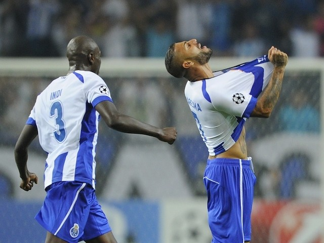 Porto's forward and captain Ricardo Quaresma (R) celebrates with teammate Dutch defender Bruno Martins Indi after scoring a goal during the UEFA Champions League football match against Bilbao on October 21, 2014