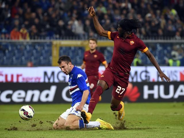 Roma's forward from Ivory Coast Gervinho fights for the ball with Sampdoria's defender Vasco Regini during the Italian Serie A football match Sampdoria vs AS Roma on October 25, 2014
