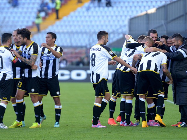 Cyril Thereau of Udinese Calcio is mobbed by team mates after scoring his team's second goal during the Serie A match between Udinese Calcio and Atalanta BC at Stadio Friuli on October 26, 2014