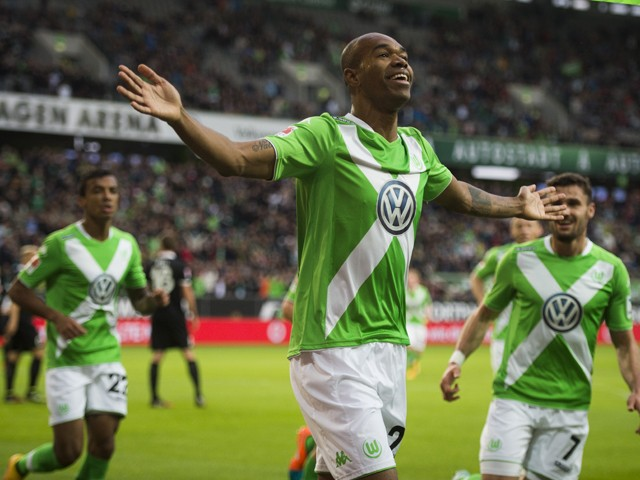 Wolfsburg's Brazilian defender Naldo (C ) celebrates scoring the opening goal during the German First division Bundesliga football match VfL Wolfsburg v 1 FSV Mainz 05 on October 26, 2014
