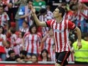 Athletic Bilbao's forward Aritz Aduriz celebrates a goal during the Spanish league football match Athletic Club Bilbao vs Sevilla FC at the San Mames stadium in Bilbao on November 2, 2014