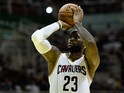 LeBron James #23 of the Cleveland Cavaliers shoots the ball against the Miami Heat at Arena HSBC on October 11, 2014 in Rio de Janeiro, Brazil