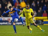 Didier Drogba of Chelsea marshalls Bobby Grant of Shrewsbury Town during the Capital One Cup Fourth Round match on October 28, 2014