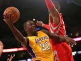 Julius Randle #30 of the Los Angeles Lakers shoots against Dwight Howard #18 of the Houston Rockets at Staples Center on October 28, 2014