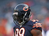 Lamarr Houston #99 of the Chicago Bears participates in warm-ups before a preseason game against the Philadelphia Eagles at Soldier Field on August 8, 2014