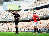 Chris Smalling of Manchester United leaves the field after receiving a red card from referee Michael Oliver during the Barclays Premier League match against Manchester City on November 2, 2014