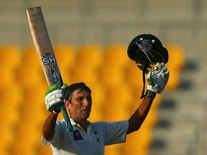 Pakistani batsman Younis Khan celebrates after scoring a century (100 runs) during the first day of the second test cricket match against Australia on October 30, 2014