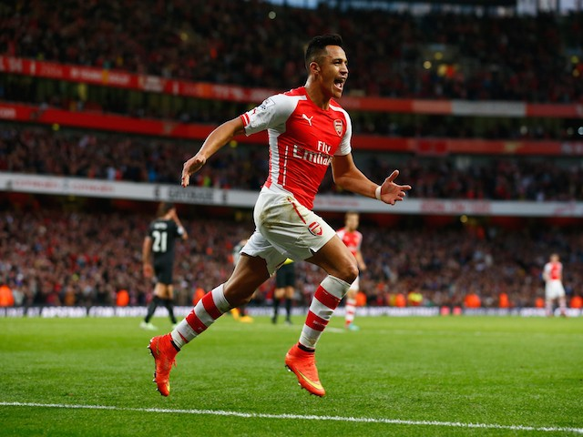 Alexis Sanchez of Arsenal celebrates scoring the first goal for Arsenal during the Barclays Premier League match against Burnley on November 1, 2014