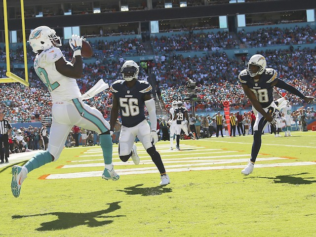 Tight end Charles Clay #42 of the Miami Dolphins catches a first quarter touchdown pass from quarterback Ryan Tannehill against the San Diego Chargers on November 2, 2014
