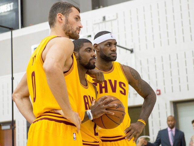 Kevin Love #0 Kyrie Irving #2 and LeBron James #23 of the Cleveland Cavaliers pose for a photo during media day at Cleveland Clinic Courts on September 26, 2014