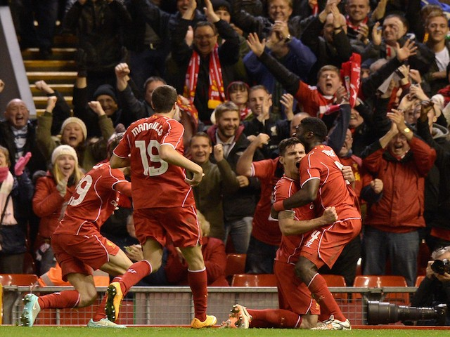 Dejan Lovren of Liverpool celebrates scoring the winning goal during the Capital One Cup Fourth Round match between Liverpool and Swansea City at Anfield on October 28, 2014