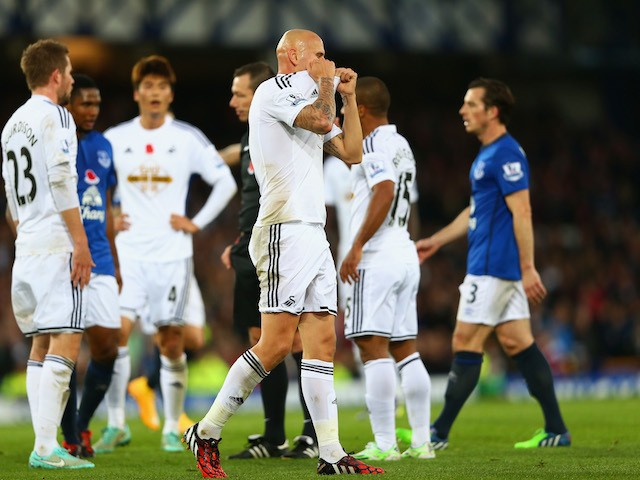 Jonjo Shelvey of Swansea City reacts after being sent off for a second yellow card during the Barclays Premier League match against Everton on November 1, 2014