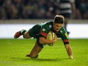 Freddie Burns of Leicester Tigers dives in to score a try during the match between Leicester Tigers and Barbarians at Welford Road on November 4, 2014