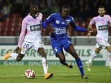 Evian's Senegalese forward Modou Sougou vies with Nice's French defender Romain Genevois during the French L1 football match Evian Thonon Gaillard FC against OGC Nice on November 8
