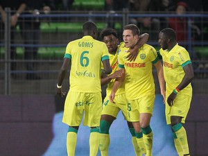 Nantes' French midfielder Jordan Veretout celebrates with his teammates after scoring a goal during the French L1 football match Caen vs Nantes on November 8, 2014