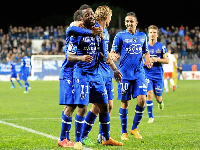 Bastia's Ivorian forward Junior Tallo celebrates with his teammates after scoring a goal during the French L1 football match Bastia (SCB) against Montpellier (MHSC) on November 8, 2014