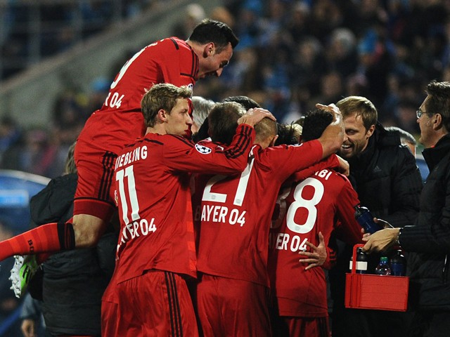 Bayer Leverkusen's football players celebrate a goal during their UEFA Champions League Group C football match between Bayer Leverkusen and Zenit at Petrovsky Stadium in St. Petersburg, Russia, on St. Petersburg on November 4, 2014