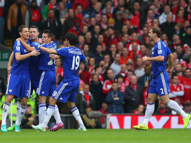 Gary Cahill of Chelsea celebrates with team mates after scoring their first goal during the Barclays Premier League match against Liverpool on November 8, 2014