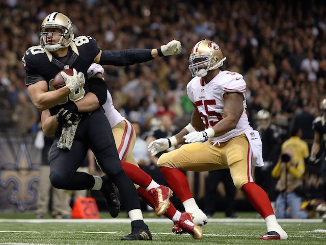 Jimmy Graham #80 of the New Orleans Saints is brought down by Chris Borland #50 of the San Francisco 49ers during the third quarter of a game on November 9, 2014