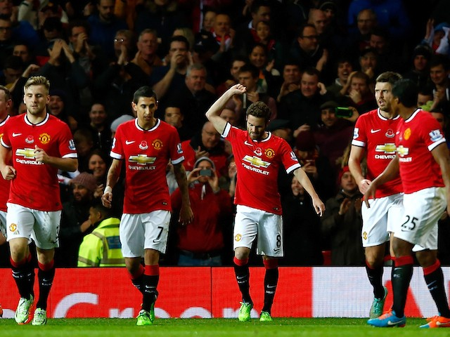 Juan Mata of Manchester United celebrates scoring the first goal during the Barclays Premier League match against Crystal Palace on November 8, 2014