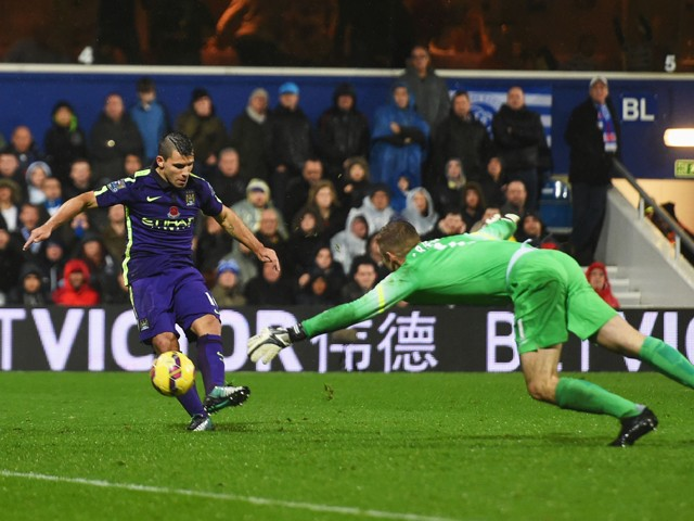 Sergio Aguero of Manchester City beats goalkeeper Robert Green of QPR to score their second goal during the Barclays Premier League match between Queens Park Rangers and Manchester City at Loftus Road on November 8, 2014
